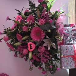 Delux floral arrangement with chocolates